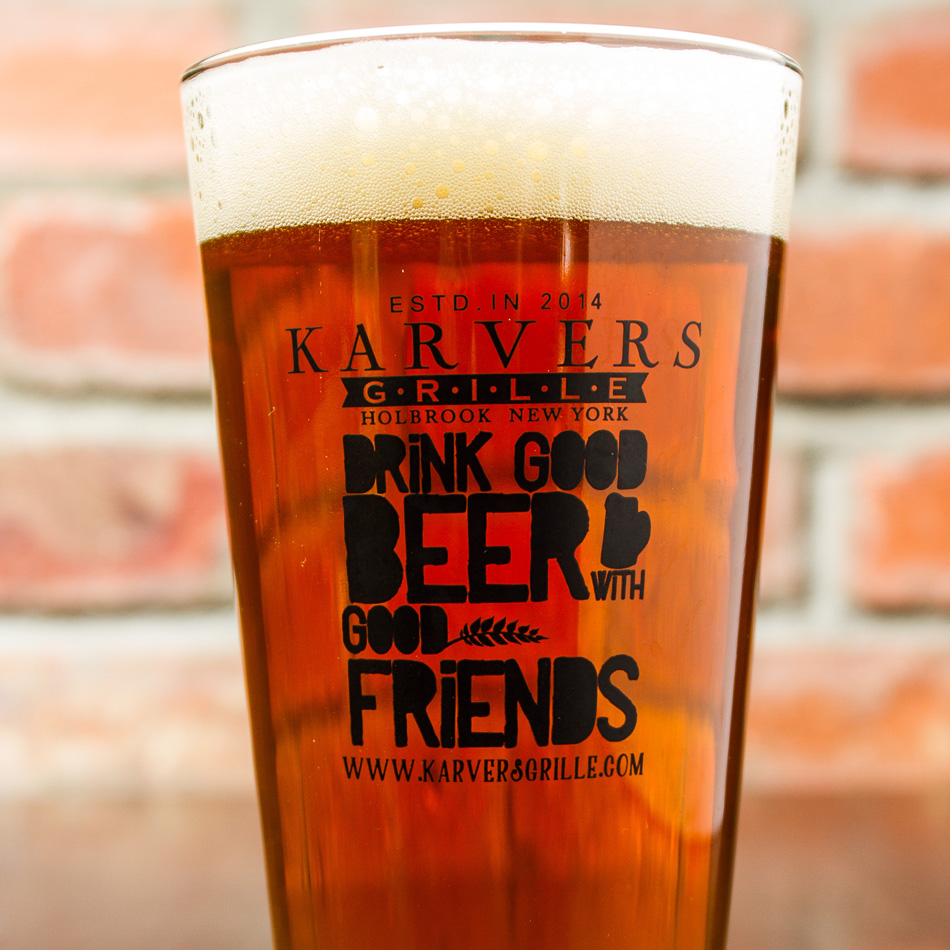 "Photo of a Karvers Pint Glasse that reads ""Drink Good Beer with Good Friends"""